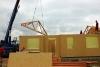 Výstavba dřevostavby - instalace střešních vazníků